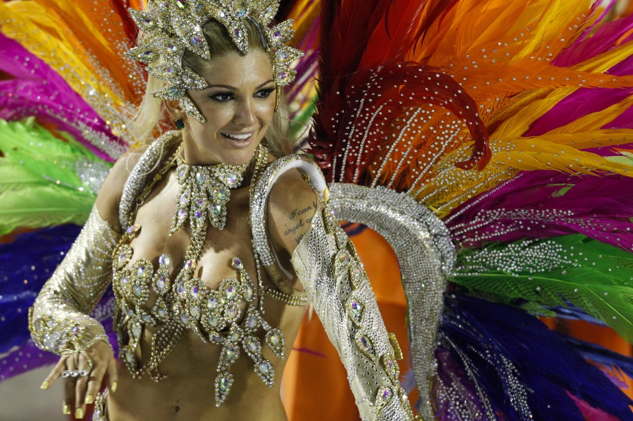 A dancer from Mocidade samba school parades during carnival celebrations at the Sambadrome in Rio de Janeiro, Brazil, Monday Feb. 20, 2012. (AP Photo/Felipe Dana)