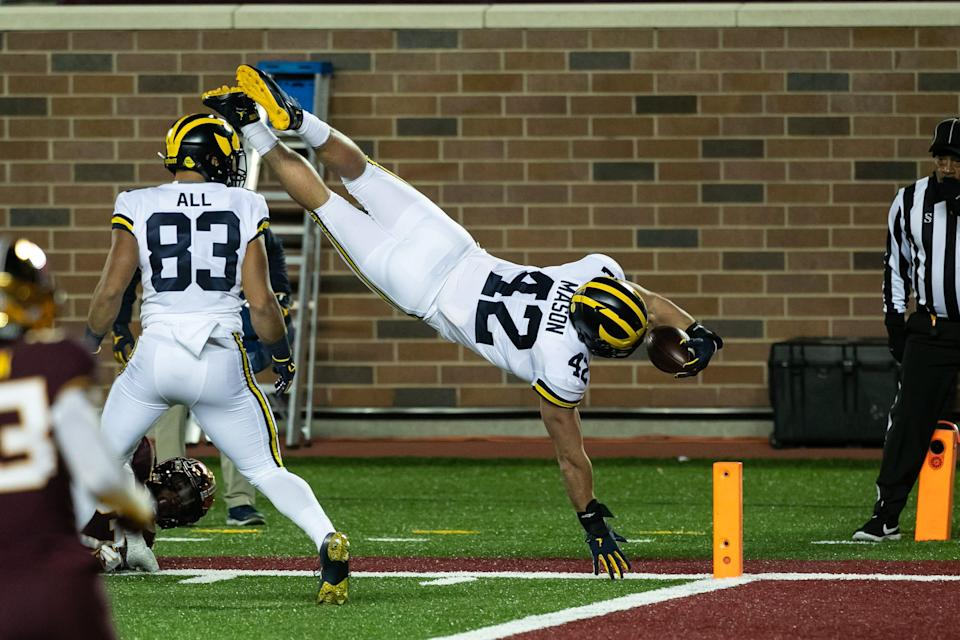 Michigan fullback Ben Mason dives for the end zone to score a touchdown in the first quarter against Minnesota at TCF Bank Stadium on Oct. 24, 2020.