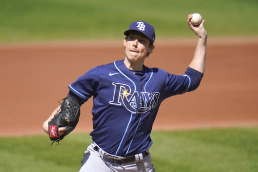 Tampa Bay Rays starting pitcher Ryan Yarbrough throws a pitch to the Baltimore Orioles during the second inning of a baseball game, Sunday, Sept. 20, 2020, in Baltimore. (AP Photo/Julio Cortez)