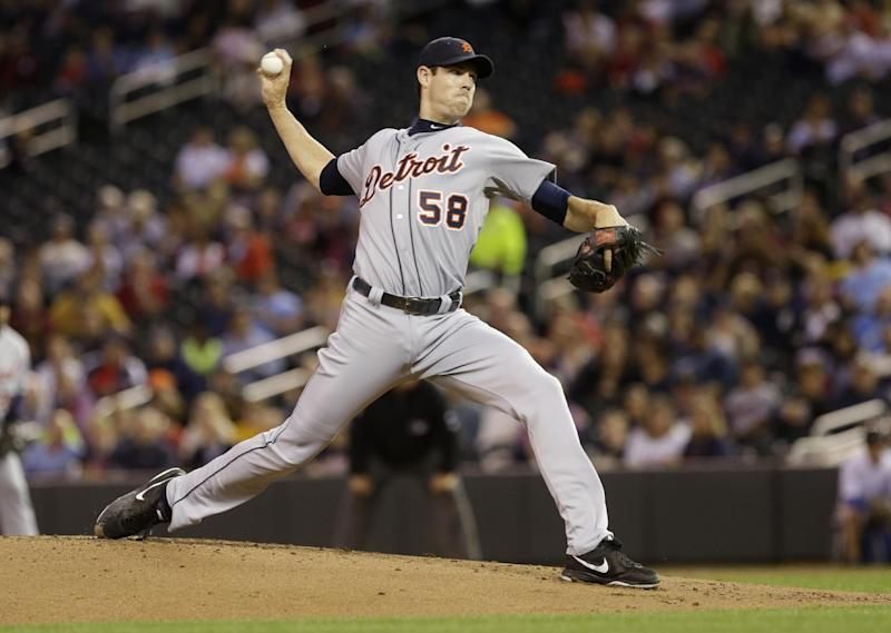 Detroit Tigers pitcher Doug Fister throws against the Minnesota Twins in the first inning of a baseball game, Tuesday, Sept. 24, 2013, in Minneapolis. (AP Photo/Jim Mone)