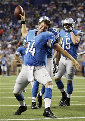 Detroit Lions quarterback Shaun Hill (14) spikes the ball after scoring on a 1-yard run in the first quarter of an NFL preseason football game against the Buffalo Bills as Detroit's Austin Wells (45) looks on Thursday, Aug. 30, 2012, in Detroit. (AP Photo/Duane Burleson)