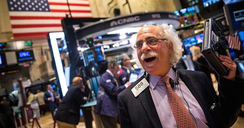 Record-setting day: Dow's first finish above 18,000