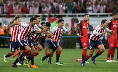 Soccer Football - CONCACAF Champions League Final Second Leg - Guadalajara vs Toronto FC - Estadio Akron, Guadalajara, Mexico - April 25, 2018 Guadalajara players celebrate winning the CONCACAF Champions League Final REUTERS/Henry Romero