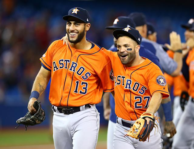 Abraham Toro #13 and Jose Altuve #27 of the Houston Astros celebrate a no hitter by teammate Justin Verlander #35 at the end of the ninth inning. (Photo by Vaughn Ridley/Getty Images)