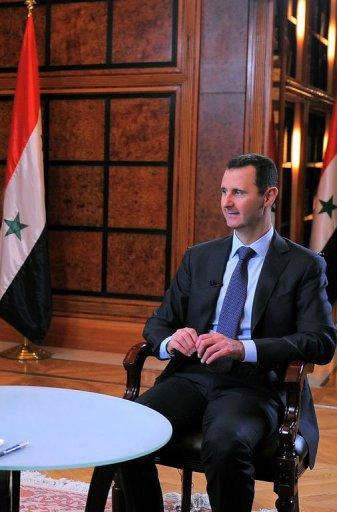 Syrian President Bashar al-Assad gives an interview in Damascus with Syria's state television channel Al-Ikhbariya, on April 17, 2013