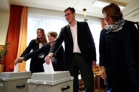 Karacsony, opposition parties' candidate casts his ballot with his family during Hungary's local elections in Budapest