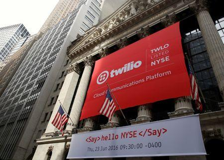 A banner for communications software provider Twilio Inc., hangs on the facade at the NYSE to celebrate the company's IPO, in New York City