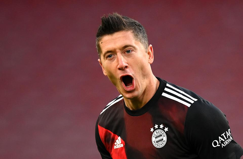 STUTTGART, GERMANY - NOVEMBER 28: Robert Lewandowski of FC Bayern Munich celebrates after scoring his team's second goal during the Bundesliga match between VfB Stuttgart and FC Bayern Muenchen at Mercedes-Benz Arena on November 28, 2020 in Stuttgart, Germany. Germany. Football Stadiums around Europe remain empty due to the Coronavirus Pandemic as Government social distancing laws prohibit fans inside venues resulting in fixtures being played behind closed doors. (Photo by Matthias Hangst/Getty Images)
