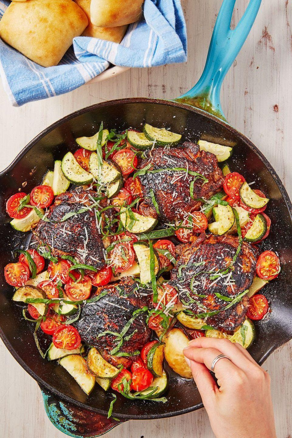 """<p>This is the perfect weeknight dinner. After marinating the chicken, everything — including the veggie side! — comes together in one pan in less than 30 minutes. Call it another <a href=""""https://www.delish.com/uk/chicken-recipes/"""" rel=""""nofollow noopener"""" target=""""_blank"""" data-ylk=""""slk:chicken dinner"""" class=""""link rapid-noclick-resp"""">chicken dinner</a> win!</p><p>Get the <a href=""""https://www.delish.com/uk/cooking/recipes/a29794011/balsamic-basil-chicken-recipe/"""" rel=""""nofollow noopener"""" target=""""_blank"""" data-ylk=""""slk:Balsamic Basil Chicken"""" class=""""link rapid-noclick-resp"""">Balsamic Basil Chicken </a>recipe.</p>"""