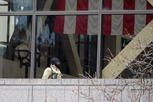 A National Guard soldier stands outside a balcony at the Hennepin County Government Center, where the Chauvin trial is being held.