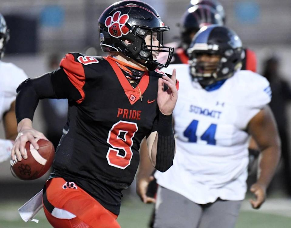 Colleyville Heritage quartrback AJ Smith- Shawver, left, scrambles away from Mansfield Summit's Karon Thomas in the fourth quarter of their Division 1-5A Regional Round Play-off football game Saturday, December 26, 2020 at Bearcat Stadium in Aledo, Texas. Special/Bob Haynes