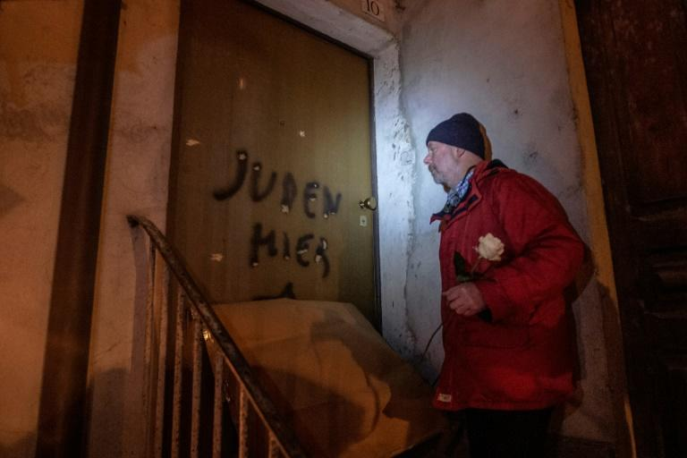 Aldo Rolfi, son of Italian writer Lidia Beccaria Rolfi (1925-1996), a former member of the Italian Resistance who was deported to Ravensbrueck concentration camp as a political prisoner, shows anti-Semitic tags written on his door to protesters