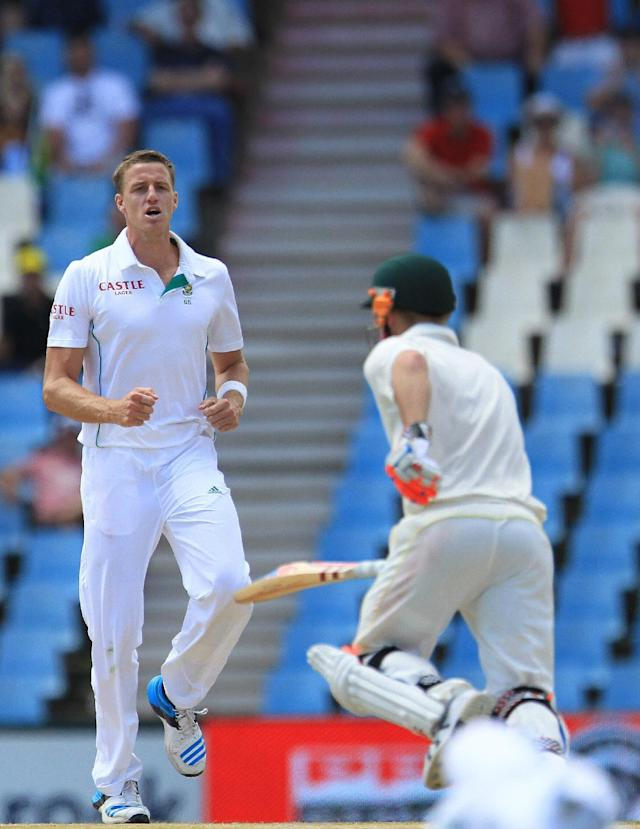 South Africa's bowler Morne Morkel, left, reacts after a teammate dropped a catch off Australia's batsman David Warner, right, on the third day of their their cricket Test match at Centurion Park in Pretoria, South Africa, Friday, Feb. 14, 2014. (AP Photo/ Themba Hadebe)
