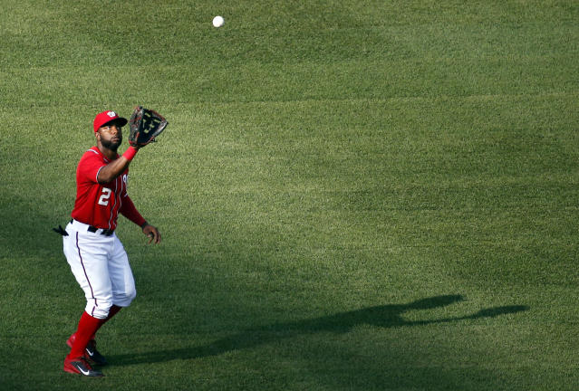 Washington Nationals center fielder Denard Span catches a fly ball hit by Pittsburgh Pirates' Gregory Polanco during the third inning of a baseball game at Nationals Park, Sunday, Aug. 17, 2014, in Washington. (AP Photo/Alex Brandon)