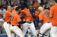 Houston Astros' Yordan Alvarez, center, celebrates with teammates after hitting a game-winning RBI-double during the ninth inning of a baseball game against the Chicago White Sox Friday, June 18, 2021, in Houston. The Astros won 2-1. (AP Photo/David J. Phillip)