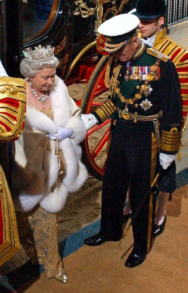 <p> Prince Philip being the perfect gentleman to the Queen, helping her out as they arrive at The Sovereign's Entrance Of The House Of Lords For The State Opening Of Parliament, in London, November, 2004.</p>