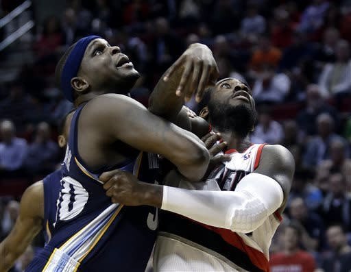 Memphis Grizzlies forward Zach Randolph, left, and Portland Trail Blazers forward J.J. Hickson battle for position under the basket for a rebound during the second half of an NBA basketball game in Portland, Ore., Wednesday, April 3, 2013. Randolph scored 17 points and pulled in 8 rebounds as Memphis won 94-76.(AP Photo/Don Ryan)