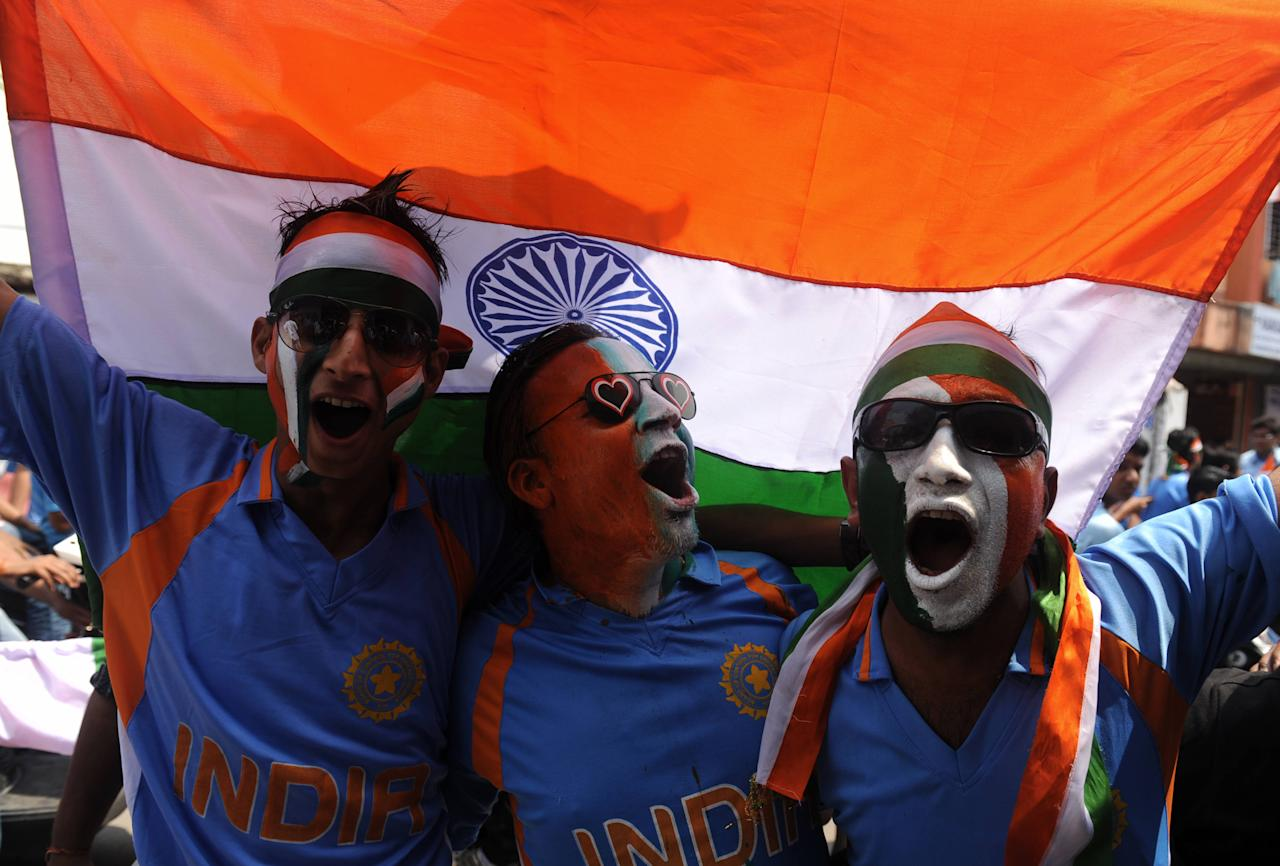 Indian cricket fans cheer in support of India's cricket team wearing the national colours in Siliguri on April 2, 2011, as India plays with Sri Lanka at Wankhede Stadium in Mumbai for the final match in the Cricket World Cup. AFP PHOTO/Diptendu DUTTA (Photo credit should read DIPTENDU DUTTA/AFP/Getty Images)