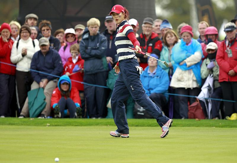 U.S. golfer Michelle Wie reacts to a putt on the 11th green during the Singles match against Europe's Suzann Pettersen on day three of the Solheim Cup at Killeen Castle, Dunsany, Ireland, Sunday, Sept. 25, 2011.  (AP Photo/Peter Morrison)