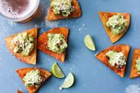 """<p>Each chip gets its own dollop of guac here, topped with Cotija cheese.</p><p><strong><a href=""""https://www.thepioneerwoman.com/food-cooking/recipes/a91363/guacamole-tostada-bites/"""" rel=""""nofollow noopener"""" target=""""_blank"""" data-ylk=""""slk:Get the recipe."""" class=""""link rapid-noclick-resp"""">Get the recipe.</a></strong></p><p><strong><a class=""""link rapid-noclick-resp"""" href=""""https://go.redirectingat.com?id=74968X1596630&url=https%3A%2F%2Fwww.walmart.com%2Fbrowse%2Fhome%2Ffood-prep%2F4044_623679_133020_642199%3Ffacet%3Dbrand%253AThe%2BPioneer%2BWoman&sref=https%3A%2F%2Fwww.thepioneerwoman.com%2Ffood-cooking%2Fmeals-menus%2Fg35049189%2Fsuper-bowl-food-recipes%2F"""" rel=""""nofollow noopener"""" target=""""_blank"""" data-ylk=""""slk:SHOP MIXING BOWLS"""">SHOP MIXING BOWLS</a><br></strong></p>"""