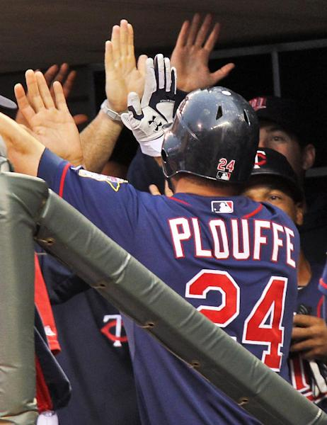 Minnesota Twins' Trevor Plouffe (24) is congratulated by teammates in the dugout after hitting a home run in the fifth inning against the Milwaukee Brewers in Minneapolis, Friday, June 15, 2012. (AP Photo/The Star Tribune, Marlin Levison) ST. PAUL PIONEER PRESS OUT; MINNEAPOLIS-AREA TV NOT TV OUT; MAGAZINES OUT