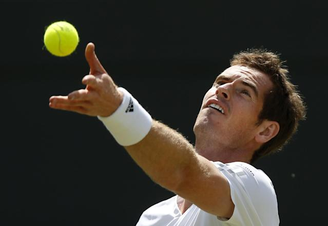 Andy Murray of Britain serves Biaz Rola of Slovenia during their men's singles match at the All England Lawn Tennis Championships in Wimbledon, London, Wednesday, June 25, 2014. (AP Photo/Sang Tan)