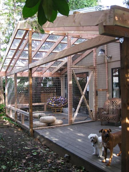 This undated photo provided by Carrie Fagerstrom shows Fagerstrom's catio which cost $5,000 to build at her home, so her eight cats can enjoy the outdoors, but not the harmful elements that come along with it, in Portland, Ore. The playground for the cats has an 11 foot by 14 foot base and is 11 feet high, with mesh wiring on the sides and a clear roof. The room includes scratching posts, a small water fountain and plenty of toys to entertain them. (AP Photo, Carrie Fagerstrom)