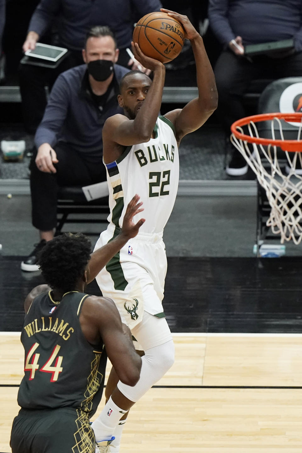 Milwaukee Bucks forward Khris Middleton, right, shoots against Chicago Bulls forward Patrick Williams during the first half of an NBA basketball game in Chicago, Friday, April 30, 2021. (AP Photo/Nam Y. Huh)