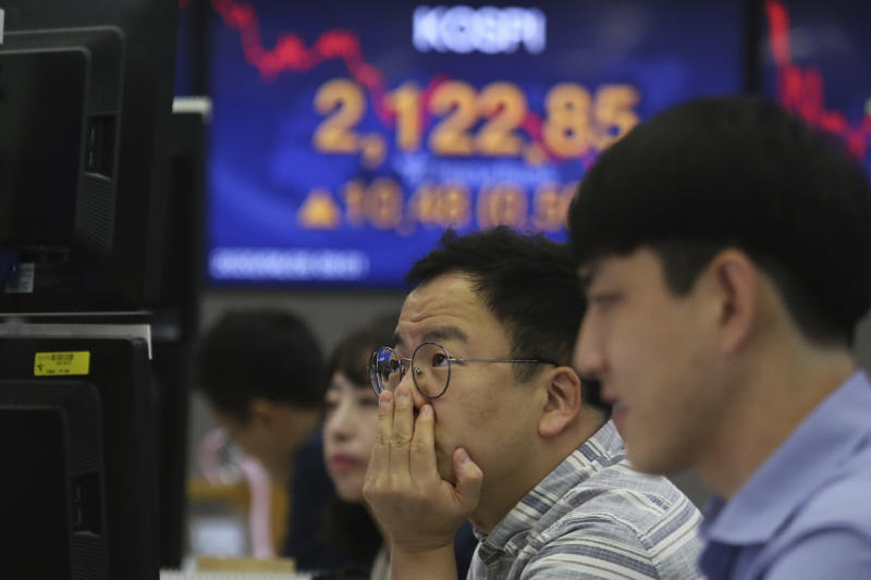 A currency trader watches monitors at the foreign exchange dealing room of the KEB Hana Bank headquarters in Seoul, South Korea, Friday, June 26, 2020. Asian stock markets followed Wall Street higher on Friday after U.S. regulators removed some limits on banks' ability to make investments. (AP Photo/Ahn Young-joon)