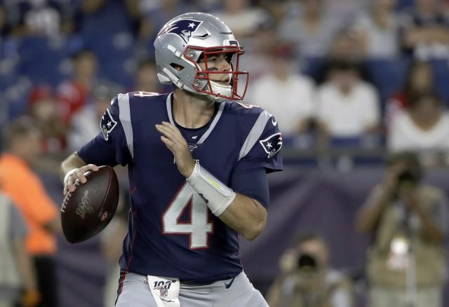 New England Patriots quarterback Jarrett Stidham drops back to pass against the New York Giants in the first half of an NFL preseason football game, Thursday, Aug. 29, 2019, in Foxborough, Mass. (AP Photo/Elise Amendola)