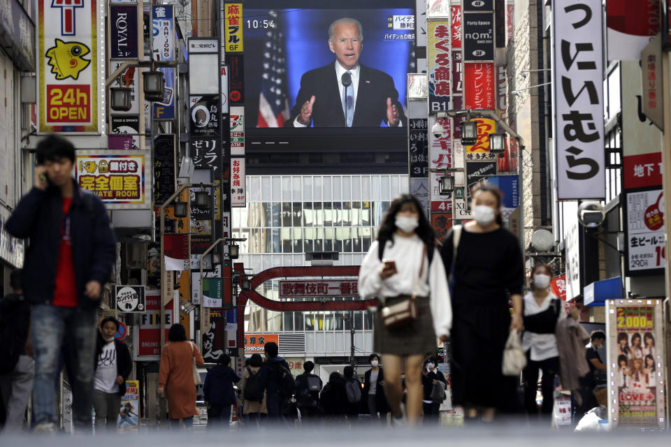 A screen shows a live broadcast of President-elect Joe Biden speaking Sunday, on Sunday, at the Shinjuku shopping district in Tokyo, Japan. Photo: Kiichiro Sato/AP