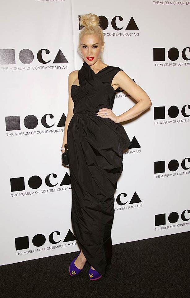 Later that same evening, Stefani slipped in to yet another eyesore for the Museum of Contemporary Art's annual gala. This time she decided to don a black taffeta Carven Spring 2012 dress, which resembled a billowing garbage bag. (11/12/2011)