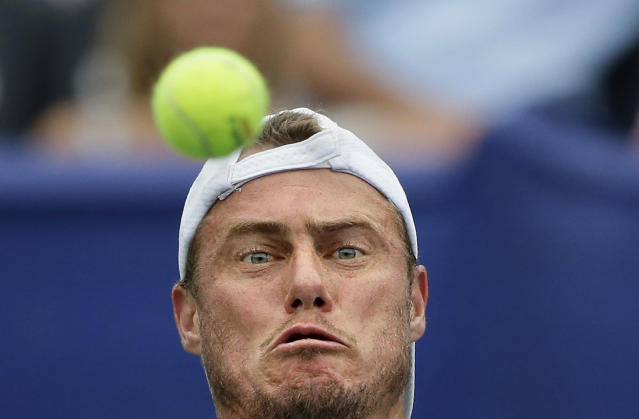 <p>Lleyton Hewitt, of Australia, returns a shot during a semifinal match against John Isner at the Atlanta Open tennis tournament, July 27, 2013, in Atlanta. (AP Photo/David Goldman) </p>