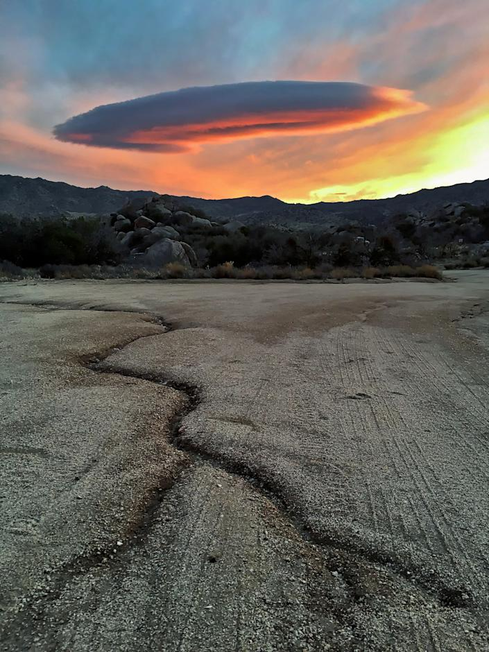 Symmetrical cloud formation over desert landscape, Anza Borrego State Park, California.