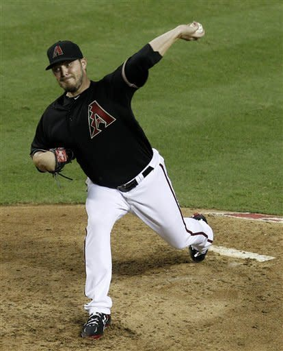 Arizona Diamondbacks' Wade Miley throws against the Houston Astros in the third inning during a baseball game Saturday, July 21, 2012, in Phoenix. (AP Photo/Ross D. Franklin)