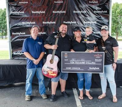 Janky Leg BBQ is presented with $10,000 for securing the overall title at the inaugural Smithfield Classic in Nashville, Tenn.