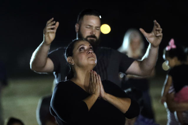 <p>Mourners pray in a vigil for the victims of the First Baptist Church shooting Monday, Nov. 6, 2017, in Sutherland Springs, Texas. (Photo: David J. Phillip/AP) </p>