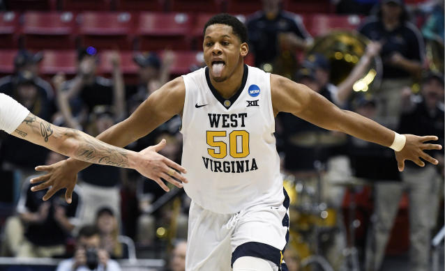 West Virginia forward Sagaba Konate (50) reacts after scoring during the second half of a second-round NCAA college basketball tournament game against Marshall, Sunday, March 18, 2018, in San Diego. West Virginia defeated Marshall 94-71. (AP Photo/Denis Poroy)