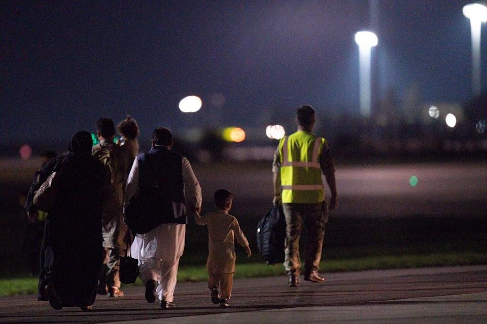 British nationals and Afghan evacuees depart a flight from Afghanistan at RAF Brize Norton (Jacob King/PA) (PA Wire)