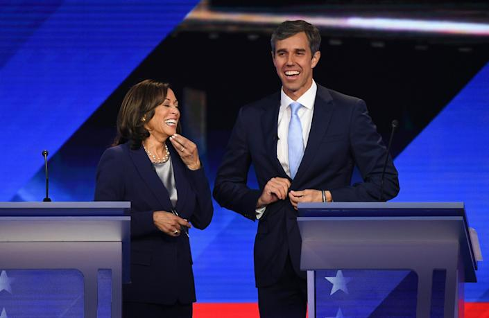 Democratic presidential hopefuls California Senator Kamala Harris and Former Texas Representative Beto O'Rourke share a laugh during a break in the third Democratic primary debate of the 2020 presidential campaign season hosted by ABC News in partnership with Univision at Texas Southern University in Houston, Texas on Sept. 12, 2019.