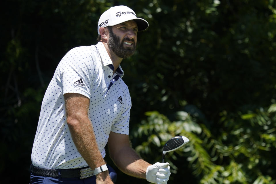 Dustin Johnson watches his tee shot on the sixth hole during the second round of the Charles Schwab Challenge golf tournament at the Colonial Country Club in Fort Worth, Texas, Friday, June 12, 2020. (AP Photo/David J. Phillip)