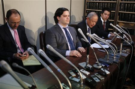 "Mark Karpeles (2nd L), chief executive of Mt. Gox, attends a news conference at the Tokyo District Court in Tokyo February 28, 2014. Mt. Gox, once the world's biggest bitcoin exchange, filed for bankruptcy protection on Friday, saying it may have lost all of its investors' virtual coins due to hacking into its faulty computer system. Karpeles, bowing in contrition and wearing a suit instead of his customary T-shirt, apologised in Japanese at a news conference for the company's collapse, blaming ""a weakness in our system."" REUTERS/Yuya Shino"