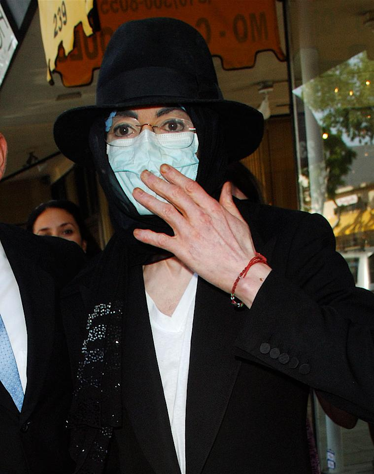 """A masked Michael Jackson hit up three antique stores in Beverly Hills Wednesday. A massive auction of his memorabilia that was scheduled for last week was canceled after the pop star and auction organizers settled their dispute. Fapian/Zodiac/<a href=""""http://www.splashnewsonline.com"""" target=""""new"""">Splash News</a> - April 22, 2009"""