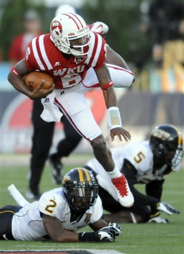 Western Kentucky quarterback Kawaun Jakes (6) is upended by Southern Mississippidefensive back Martez Thompson (2) in the first half of an NCAA college football game at Houchens-Smith Stadium in Bowling Green, Ky., Saturday, Sept. 22, 2012. (AP Photo/Daily News, Joe Imel)