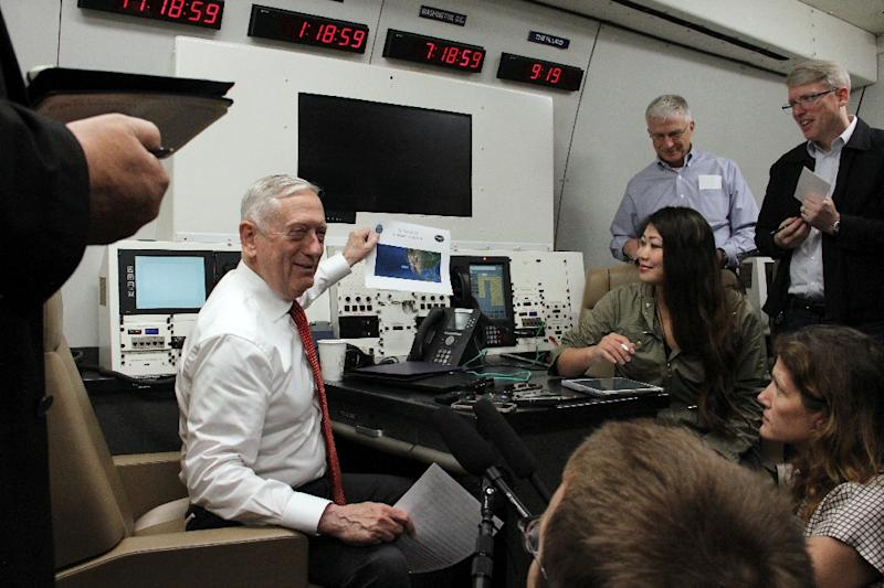 US Defense Secretary Jim Mattis speaks to reporters aboard a US military plane