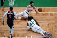 Boston Celtics forward Jayson Tatum (0) scrambles after the ball as center Robert Williams III (44) falls to the floor after a rebound during the first half of an NBA basketball Eastern Conference play-in game Tuesday, May 18, 2021, in Boston. At left is Washington Wizards guard Russell Westbrook. (AP Photo/Charles Krupa)