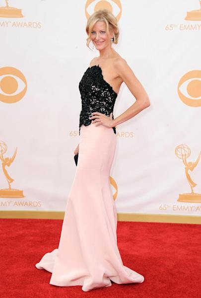 Anna Gunn, wearing Ramona Keveza, arrives at the 65th Primetime Emmy Awards at Nokia Theatre on Sunday Sept. 22, 2013, in Los Angeles. (Photo by Jordan Strauss/Invision/AP)