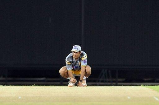Pakistan captain Misbah-ul-Haq inspects the pitch during a practice session in Colombo Tuesday