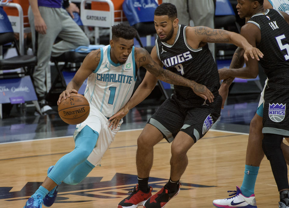 Charlotte Hornets guard Malik Monk (1) drives to the hoop past Sacramento Kings guard Cory Joseph (9) during the second half of an NBA basketball game in Sacramento, Calif., Sunday, Feb. 28, 2021. The Hornets won 127-126. (AP Photo/Randall Benton)