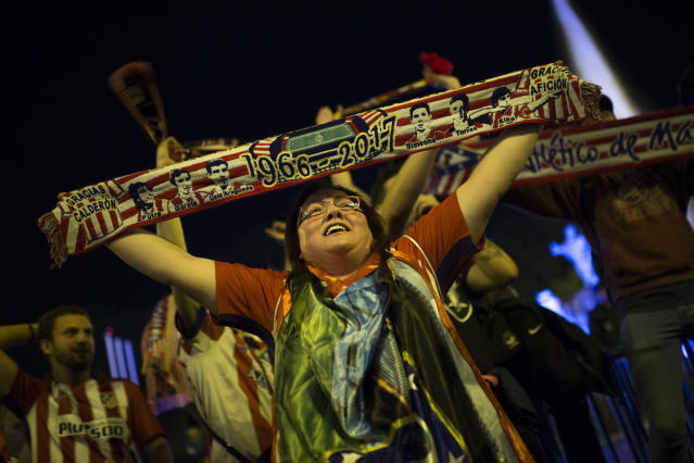 Atletico Madrid supporters celebrate their team's Europa League tittle in Madrid, Wednesday, May 16, 2018. Atletico defeated Marseille 3-0 in the final and clinches its third Europa League title. (AP Photo/Francisco Seco)